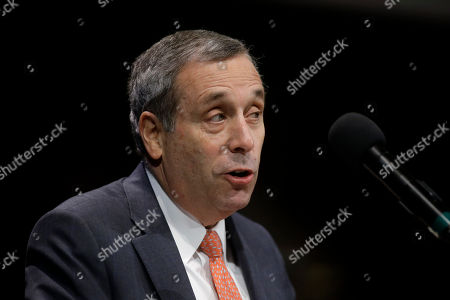 Stock Image of Harvard University President Lawrence Bacow addresses an audience during W.E.B. Du Bois Medal ceremonies, at Harvard University, in Cambridge, Mass. Former NFL football quarterback Colin Kaepernick is among eight recipients of Harvard University's W.E.B. Du Bois Medals in 2018. Harvard has awarded the medal since 2000 to people whose work has contributed to African and African-American culture