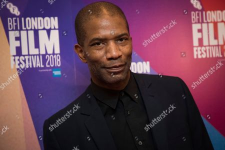 Mark Monero poses for photographers upon arrival at the screening of the film 'Happy New Year, Colin Burstead' showing as part of the BFI London Film Festival in London