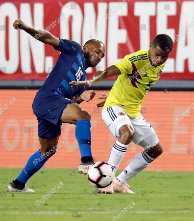 Julian Green, Wilmar Barrios. United States' Julian Green, left, tries to clear the ball away from Colombia's Wilmar Barrios during the first half of an international friendly soccer match, in Tampa, Fla