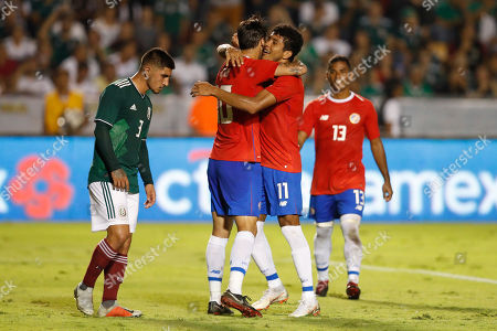 Stock Photo of Costa Rica's Bryan Ruiz, second from left, is congratulated by teammate Johan Venegas after scoring a goal on a penalty kick during a friendly soccer match between Mexico and Costa Rica in Monterrey, Mexico