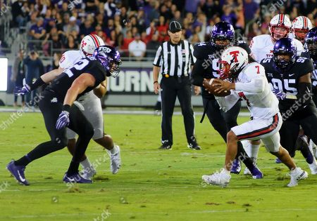 TCU Horned Frogs defensive tackle Terrell Cooper (95) pursues Texas Tech Red Raiders quarterback Jett Duffey (7) during the 1st half of the NCAA Football game between the Texas Tech Red Raiders Cyclones and the TCU Horned Frogs at Amon G. Carter in Waco, Texas