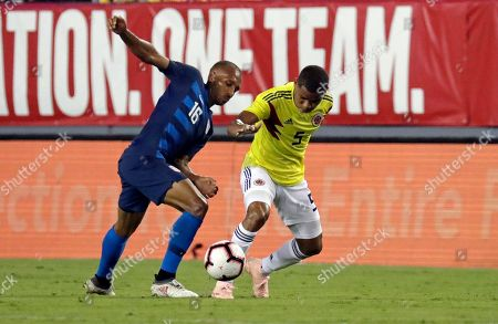 United States' Julian Green, left, tries to clear the ball away from Colombia's Wilmar Barrios during the first half of an international friendly soccer match, in Tampa, Fla