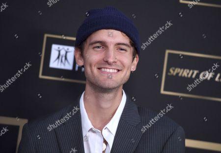 Gavin Haley arrives at the City of Hope Gala, at the Barker Hangar in Santa Monica, Calif