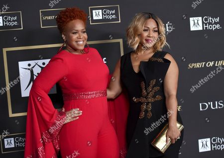 Tina Campbell, Erica Campbell. Tina Campbell, left, and Erica Campbell, of Mary Mary, arrive at the City of Hope Gala, at the Barker Hangar in Santa Monica, Calif
