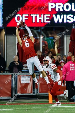 Madison, WI. U.S. - Wisconsin Badgers wide receiver Danny Davis III #6 reaches high for his touchdown reception over Nebraska Cornhuskers defensive back Eric Lee Jr. #6 in action during a NCAA Division 1 football game between Nebraska Cornhuskers and the Wisconsin Badgers at Camp Randall Stadium in Madison, WI..Attendance: 80,051.Wisconsin won 41-24