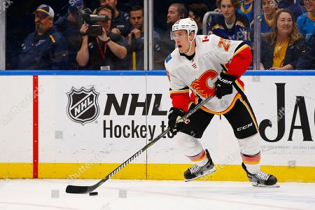 Calgary Flames' Michael Stone handles the puck during the second period of an NHL hockey game against the St. Louis Blues, in St. Louis