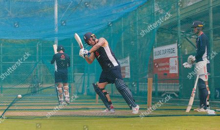 England's Jason Roy, center, bats as Alex Hales, right, watches during a practice session ahead of their second one-day international cricket match with Sri Lanka in Dambulla, Sri Lanka