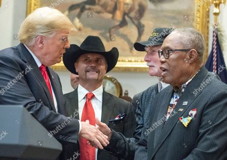 United States President Donald Trump, left, shakes hands with Mike Love of The Beach Boys, right center, prior to signing H.R. 1551, the 'Orrin G. Hatch-Bob Goodlatte Music Modernization Act' in the Roosevelt Room of the White House Looking on are John Rich of Big & Rich, left center, and Soul legend Sam Moore of Sam & Dave, right.