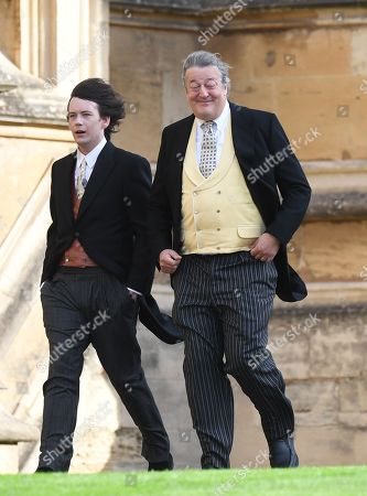 Elliott Spencer (L) and Stephen Fry (R) arrive for the royal wedding ceremony of Princess Eugenie of York and Jack Brooksbank at St George's Chapel at Windsor Castle, in Windsor, Britain, 12 October 2018.