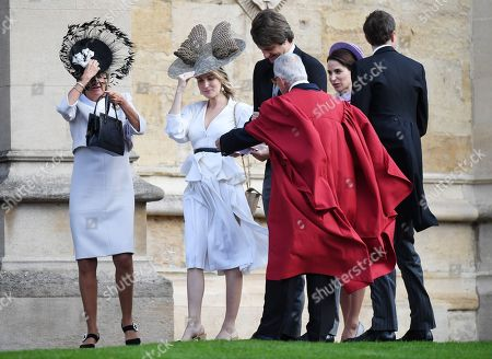 Stock Photo of Prince Ernst August of Hanover, Jr. (C) and wife Ekaterina (2-L) arrive for the royal wedding ceremony of Princess Eugenie of York and Jack Brooksbank at St George's Chapel at Windsor Castle, in Windsor, Britain, 12 October 2018.