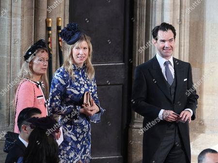 Jimmy Carr and Karoline Copping, center, arrive for the wedding of Princess Eugenie of York and Jack Brooksbank at St George's Chapel, Windsor Castle, near London, England