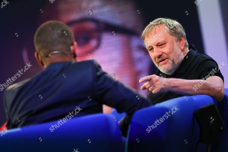 Slovenian philosopher Slavoj Zizek (R) speaks at the authors' forum 'Blue Sofa' during the book fair 'Frankfurter Buchmesse 2018', in Frankfurt am Main, Germany, 12 October 2018. The 70th edition of the international Frankfurt Book Fair, described as the 'world's most important fair for the print and digital content business' runs from 10 to 14 October and gathers authors, writers and celebrities from all over the world. This year's Guest of Honour country is Georgia.