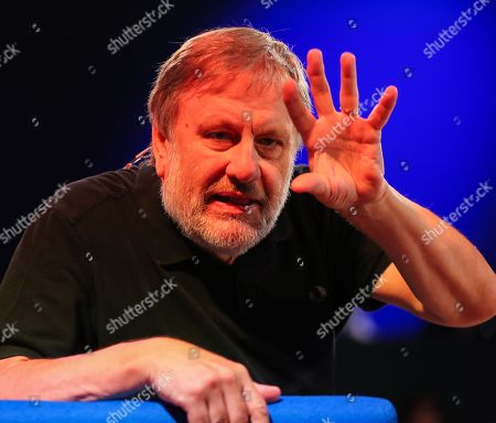Stock Photo of Slovenian philosopher Slavoj Zizek speaks at the authors' forum 'Blue Sofa' during the book fair 'Frankfurter Buchmesse 2018', in Frankfurt am Main, Germany, 12 October 2018. The 70th edition of the international Frankfurt Book Fair, described as the 'world's most important fair for the print and digital content business' runs from 10 to 14 October and gathers authors, writers and celebrities from all over the world. This year's Guest of Honour country is Georgia.