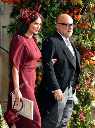 Actress Demi Moore, left, and Eric Buterbaugh depart after the wedding of Princess Eugenie of York and Jack Brooksbank at St George's Chapel, Windsor Castle, near London, England