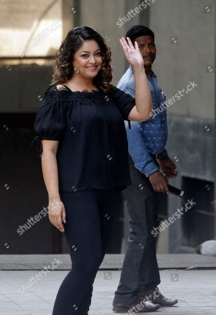 Former Bollywood actress Tanushree Dutta stands for photographs outside a media house in Mumbai, India, . A social media storm began in September, when Dutta spoke to several Indian TV news channels about her frustration with a fruitless police complaint she filed in 2008 against actor Nana Patekar for alleged sexual harassment on a Mumbai movie set. Since then, Indian actresses and writers have flooded social media in recent days with allegations of sexual harassment and assault, releasing pent-up frustration with a law that was lauded internationally but that critics say has done little to change the status quo in the world's largest democracy