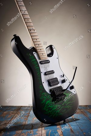 A Jackson X Series Signature Adrian Smith Sdxq Electric Guitar With A Transparent Green Burst Finish