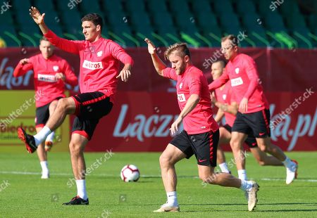 Polish national soccer team players Marcin Kaminski (L) and Jakub Blaszczykowski (C) warm-up during their team's training session in Katowice, Poland, 12 October 2018. Poland will face Italy in their UEFA Nations League soccer match on 14 October in Chorzow, Poland.