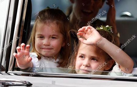 Flower Girls Princess Charlotte, left and Theodora Williams wave to the crowds following the wedding of Princess Eugenie of York and Jack Brooksbank in St George's Chapel, Windsor Castle, near London, England