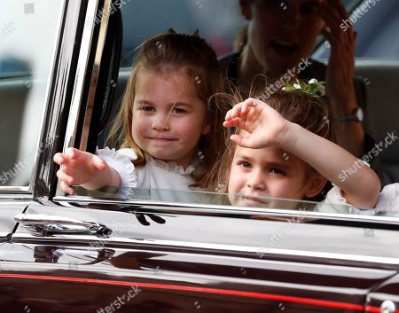 Flower Girls Princess Charlotte, left, and Theodora Williams wave to the crowds following the wedding of Princess Eugenie of York and Jack Brooksbank in St George's Chapel, Windsor Castle, near London, England