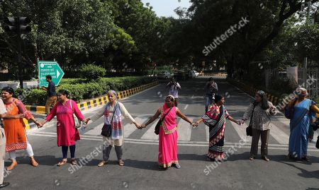 Indian activists from All India Democratic Women's Association makes a human chain during a protest against incidents of sexual assault and harassment at work place, in New Delhi, India, 12 October 2018. According to reports, Bollywood actress Tanushree Dutta filed complaint of sexual harassment against actor Nana Patekar. Indian activists from All India Democratic Women's Association show their support #MeToo movement where women sharing incidents of sexual assault and harassment.