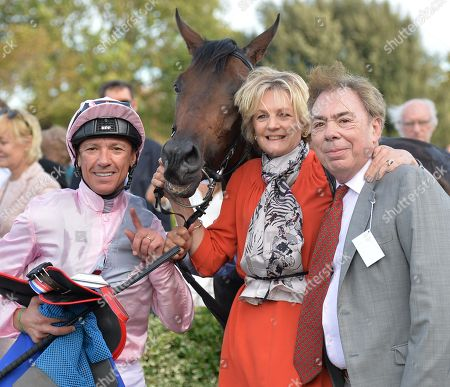Lord and Lady Lloyd Webber with jockey, Frankie Dettori, after Too Darn Hot had won The Darley Dewhurst Stakes.