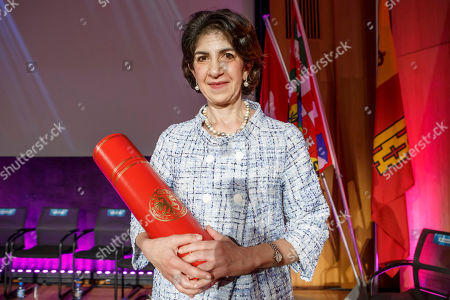 Fabiola Gianotti, Director General of the European Organization for Nuclear Research (CERN), poses for photographs after receiving the doctorate Honoris Causa, during the ceremony Dies Academics of the University of Geneve, in Geneva, Switzerland, 12 October 2018.