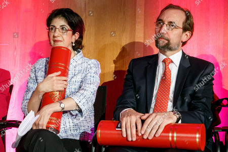 Fabiola Gianotti (L), Director General of the European Organization for Nuclear Research (CERN), and former UN High Commissioner for Human Rights, Zeid Ra'ad al Hussein (R), listen a speech after receiving the doctorate Honoris Causa, during the ceremony Dies Academics of the University of Geneve, in Geneva, Switzerland, 12 October 2018.