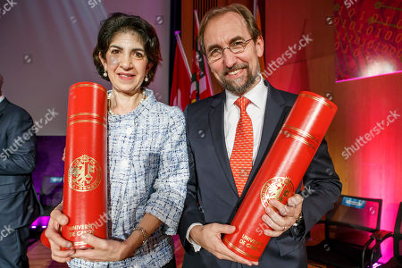 Fabiola Gianotti (L), Director General of the European Organization for Nuclear Research (CERN), and former UN High Commissioner for Human Rights, Zeid Ra'ad al Hussein, poses for photographs after receiving the doctorate Honoris Causa, during the ceremony Dies Academics of the University of Geneve, in Geneva, Switzerland, 12 October 2018.