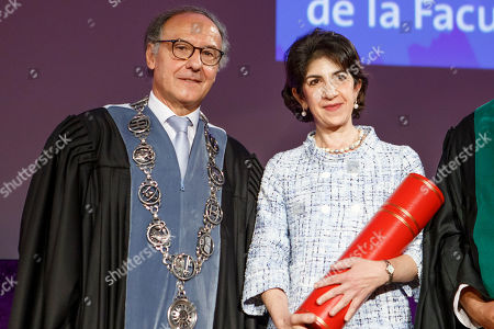 Fabiola Gianotti (R), Director General of the European Organization for Nuclear Research (CERN), receives the doctorate Honoris Causa from Yves Fluckiger (L), Rector of the University of Geneva, during the ceremony Dies Academics of the University of Geneve, in Geneva,, Switzerland, 12 October 2018.