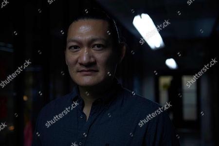 Stock Photo of Thomas Chaanhing as Felix Chong.