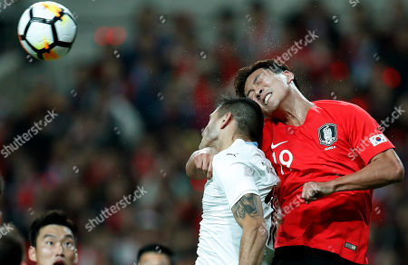 Maxi Gomez (L) of Uruguay in action against Kim Young-gwon (L) of South Korea during the International Friendly soccer match between South Korea and Uruguay at the Sangam Wourl Cup Stadium in Seoul, South Korea, 12 October 2018. South Korea won 2:1.