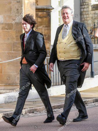 British actor and TV presenter, Stephen Fry and his partner, Elliott Spencer arrive