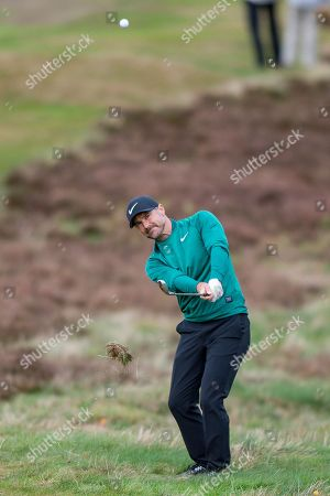 Trevor Immelman of South Africa hits out of the rough during the British Masters 2018 at Walton Heath Golf Course, Walton On the Hill. Picture by Martin Cole