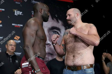 Stock Photo of Cheick Kongo, left, and Timothy Johnson square off during the ceremonial weigh-in before Bellator 208, in Melville, NY