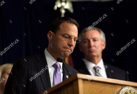 Stock Picture of Montgomery County District Attorney Kevin Steele, right, stands beside Pennsylvania Attorney General Josh Shapiro as he speaks at a news conference in Norristown, Pa. Shapiro is appealing to legislators to change state law so that civil cases can be pursued in court in decades-old clergy abuse cases. Shapiro also wants the Legislature to lift the statute of limitations for criminal prosecutions going forward. Steele prosecuted the Bill Cosby case