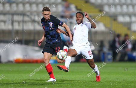 Stock Picture of Josip Pivaric of Croatia and Raheem Sterling of England