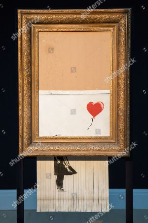 Sothebys Unveils Banksys Love Bin London Stock Photos