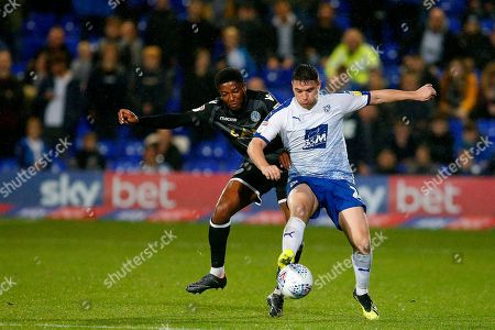 Scott Wilson of Macclesfield Town competes with Adam Buxton of Tranmere Rovers
