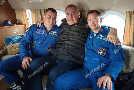 In this photo made available by Roscosmos on Friday, Oct. 12. 2018, agency leader Dmitry Rogozin, center, embraces cosmonaut Alexei Ovchinin, left, and U.S. astronaut Nick Hague at Star City, Russia, a space training center outside Moscow. After an aborted launch on Thursday, Rogozin promised that Hague and Ovchinin will be given another chance soon to work on the International Space Station