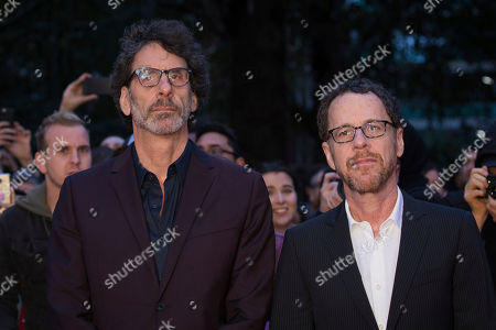 Joel Cohen, Etan Cohen. Film directors Etan Cohen, right, and Joel Cohen pose for photographers upon arrival at the premiere of the film 'The Ballad Of Buster Scruggs' showing as part of the BFI London Film Festival in London