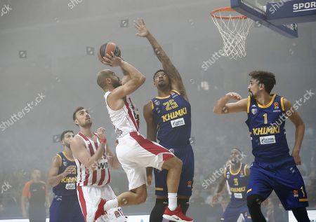 Stock Image of Dee Bost (L), Jordan Mickey (C) and Alexey Shved (R) of Khimki Moscow Region in action against Nikola Milutinov (2-L) and Vassilis Spanoulis (3-L) of Olympiacos Piraeus during the Euroleague Round 1 basketball match between Khimki Moscow Regio and  Olympiacos Piraeus in Moscow, Russia, 12 October 2018.