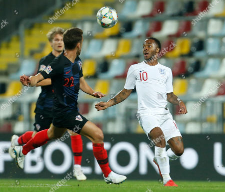 Croatia's Josip Pivaric, left, and England's Raheem Sterling vie for the ball during the UEFA Nations League soccer match between Croatia and England at Rujevica stadium in Rijeka, Croatia