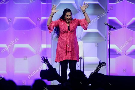Comedian and disability advocate Maysoon Zayid acknowledges the audience after speaking at the Pennsylvania Conference for Women in Philadelphia