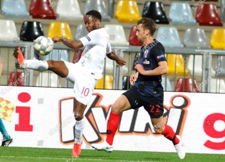 England's Raheem Sterling (L) in action against Croatia's Josip Pivaric during the UEFA Nations League match between Croatia and England at Rujevica stadium in Rijeka, Croatia, 12 October 2018.