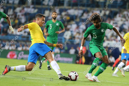 Brazilian Philippe Coutinho (L) fights for the ball against Saudi Arabia's Yasser Al-Shahrani during the friendly international soccer match between Saudi Arabia and Brazil, in Riyadh, Saudi Arabia, 12 October 2018.
