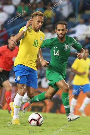 Brazil's Neymar (L) fights for the ball against Saudi Arabia's Abdullah Otayf during the friendly international soccer match between Saudi Arabia and Brazil, in Riyadh, Saudi Arabia, 12 October 2018.
