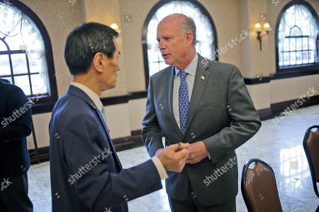 Stock Photo of Republican congressman Dan Donovan talks to a member of the Rotary Club in Staten Island, New York