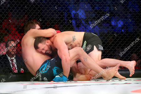 Ryan Bader, top, grapples with Matt Mitrione during a heavyweight mixed martial arts bout at Bellator 207, in Uncasville, CT, on . Bader won via unanimous decision