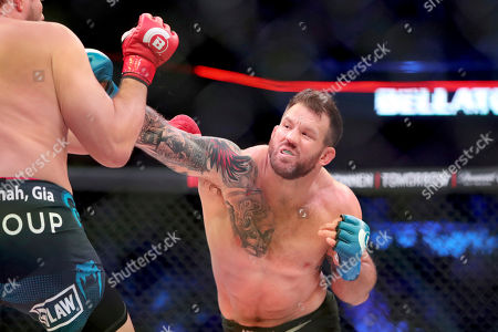 Ryan Bader, right, hits Matt Mitrione during a heavyweight mixed martial arts bout at Bellator 207, in Uncasville, CT, on . Bader won via unanimous decision