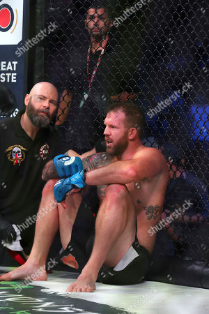 Ryan Bader sits on the canvas after his bout with Matt Mitrione in a heavyweight mixed martial arts bout at Bellator 207, in Uncasville, CT, on . Bader won via unanimous decision
